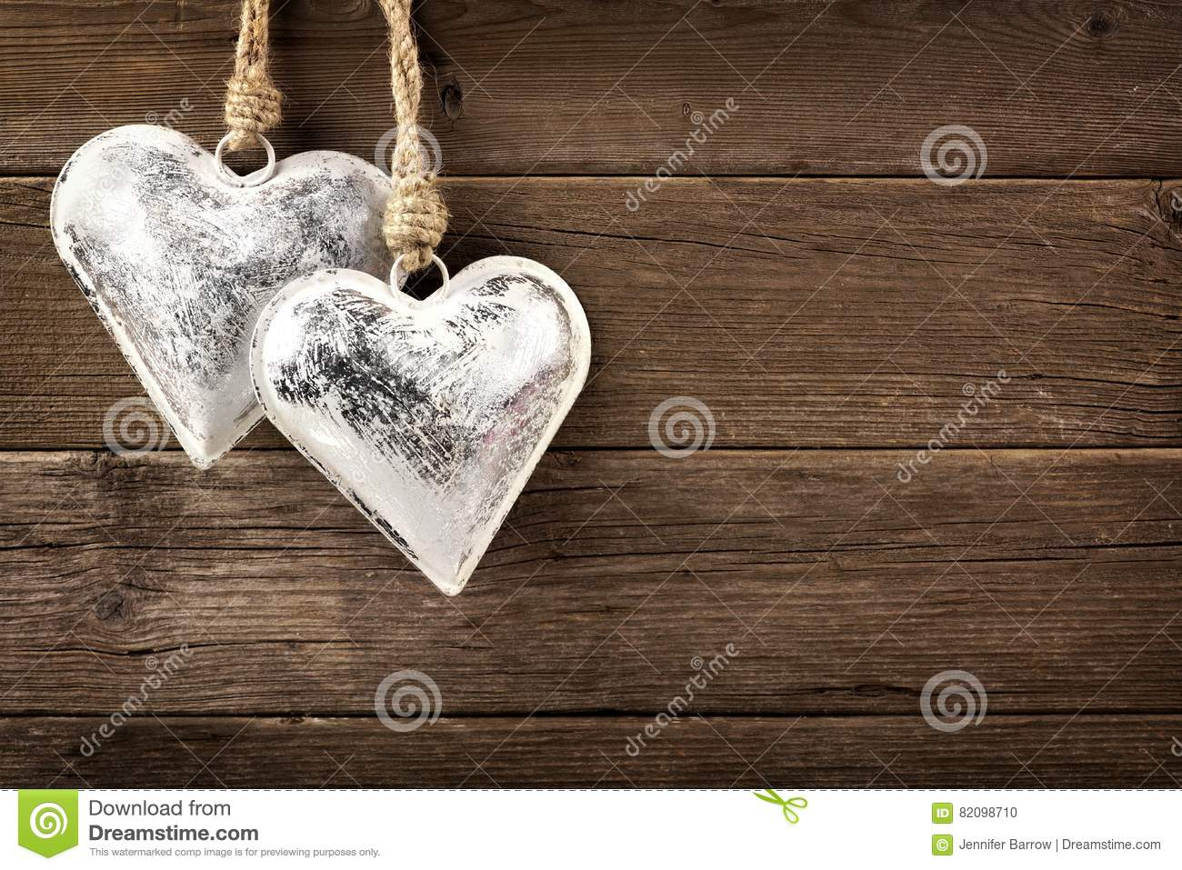 Metal heart ornaments - Two Rustic Metal Heart Ornaments Hanging On Wood
