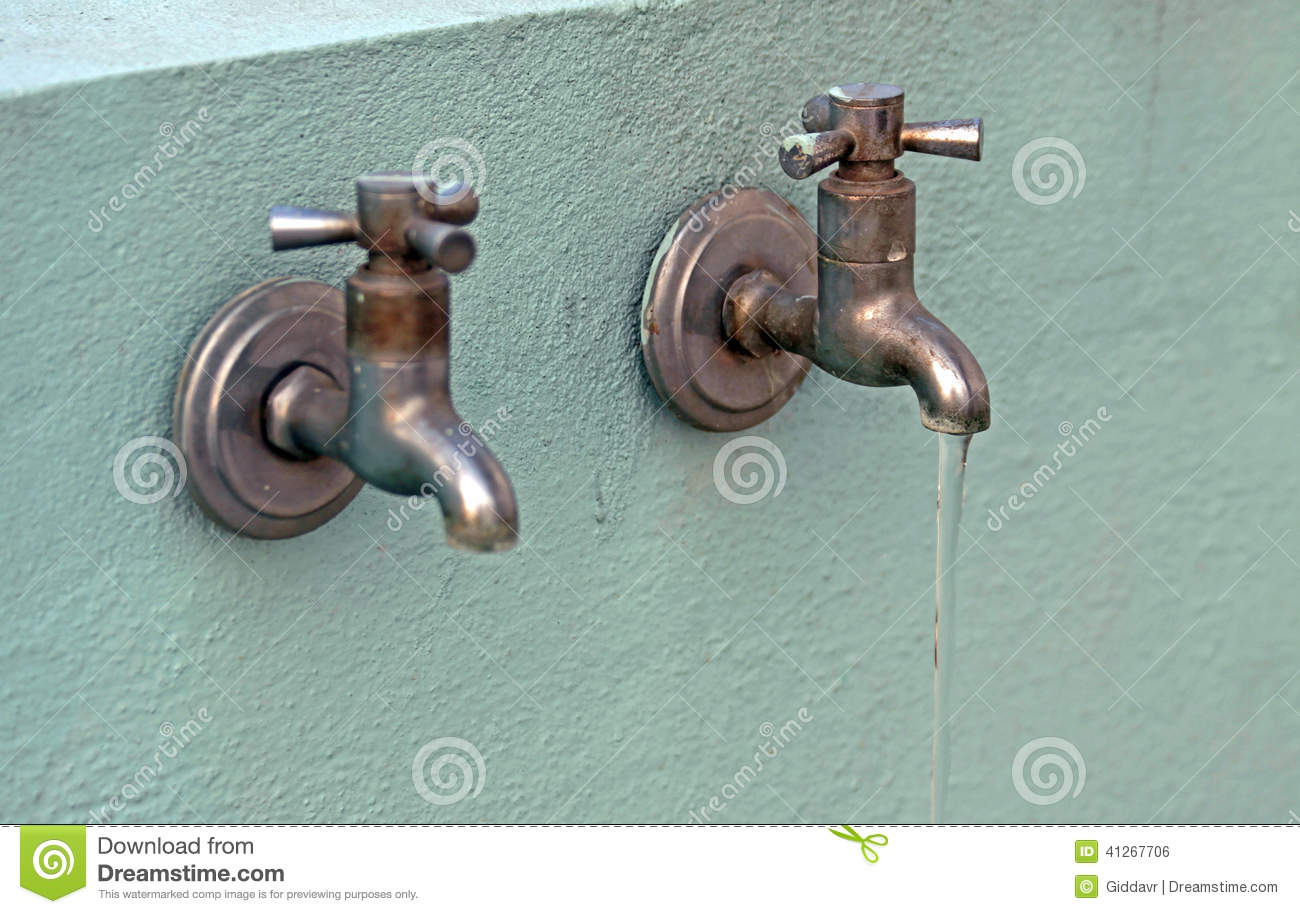 Two Rusty Old Taps With Water Flowing From One Stock Photo - Image ...