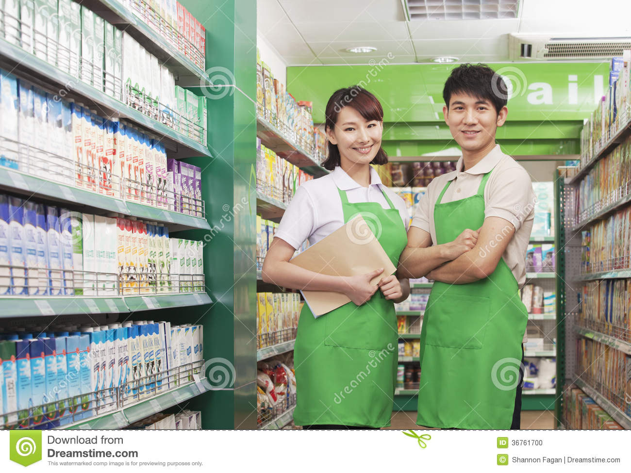 two s clerks standing in a supermarket stock photo image two s clerks standing in a supermarket stock photo