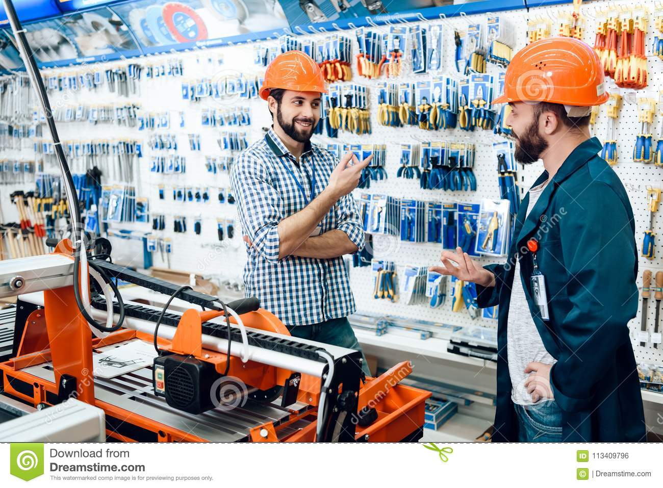 Two Salesmen Are Discussing Equipment Selection Near Woodworking