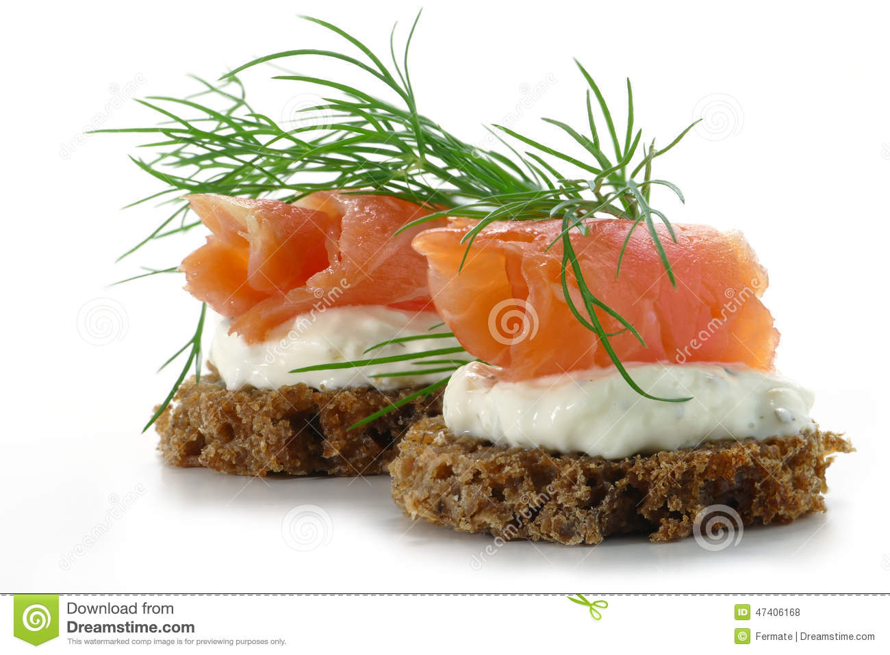two salmon canapes with fresh dill garnish isolated on