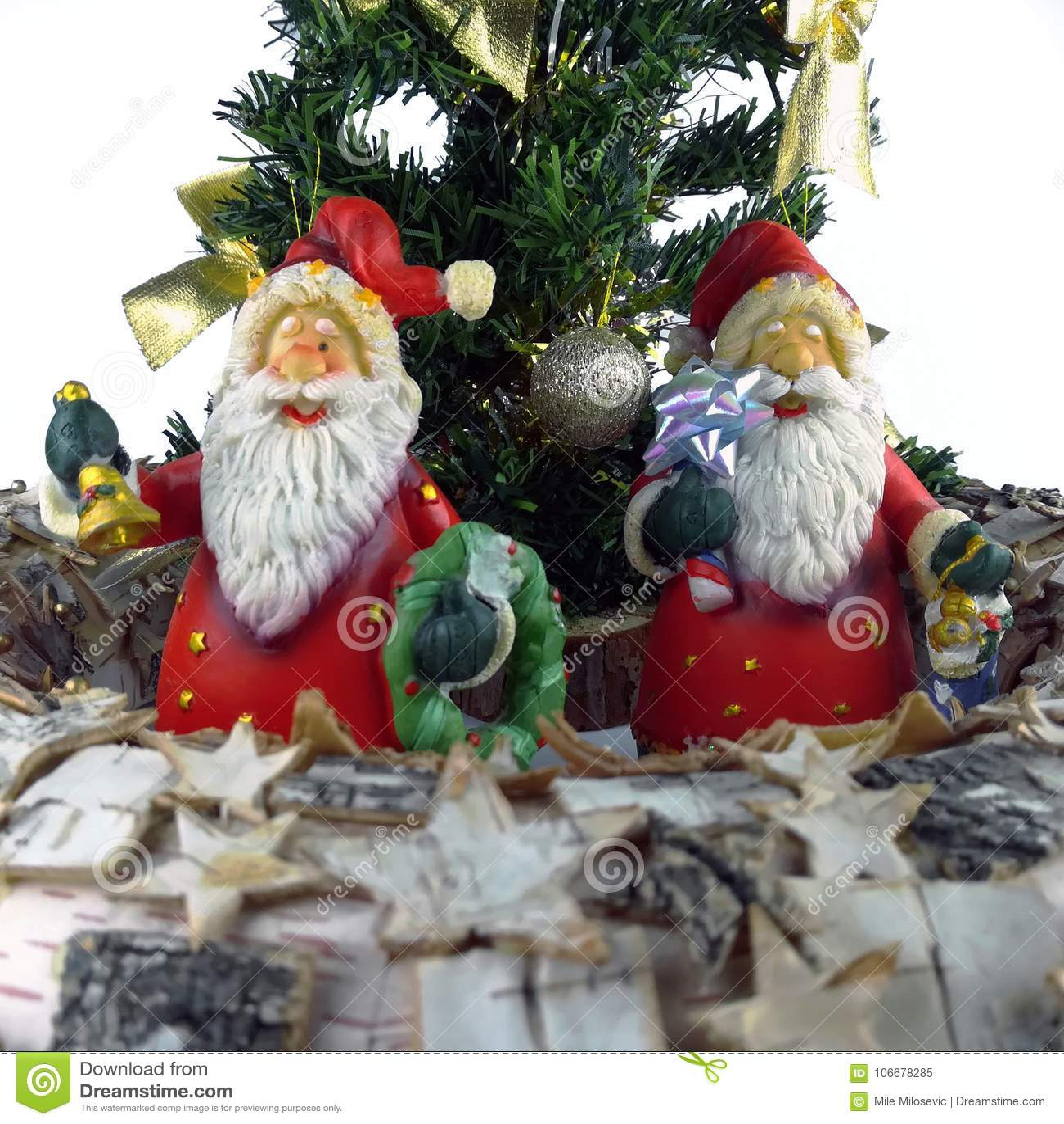 Two Santa Claus Figurine And Mini Christmas Trees
