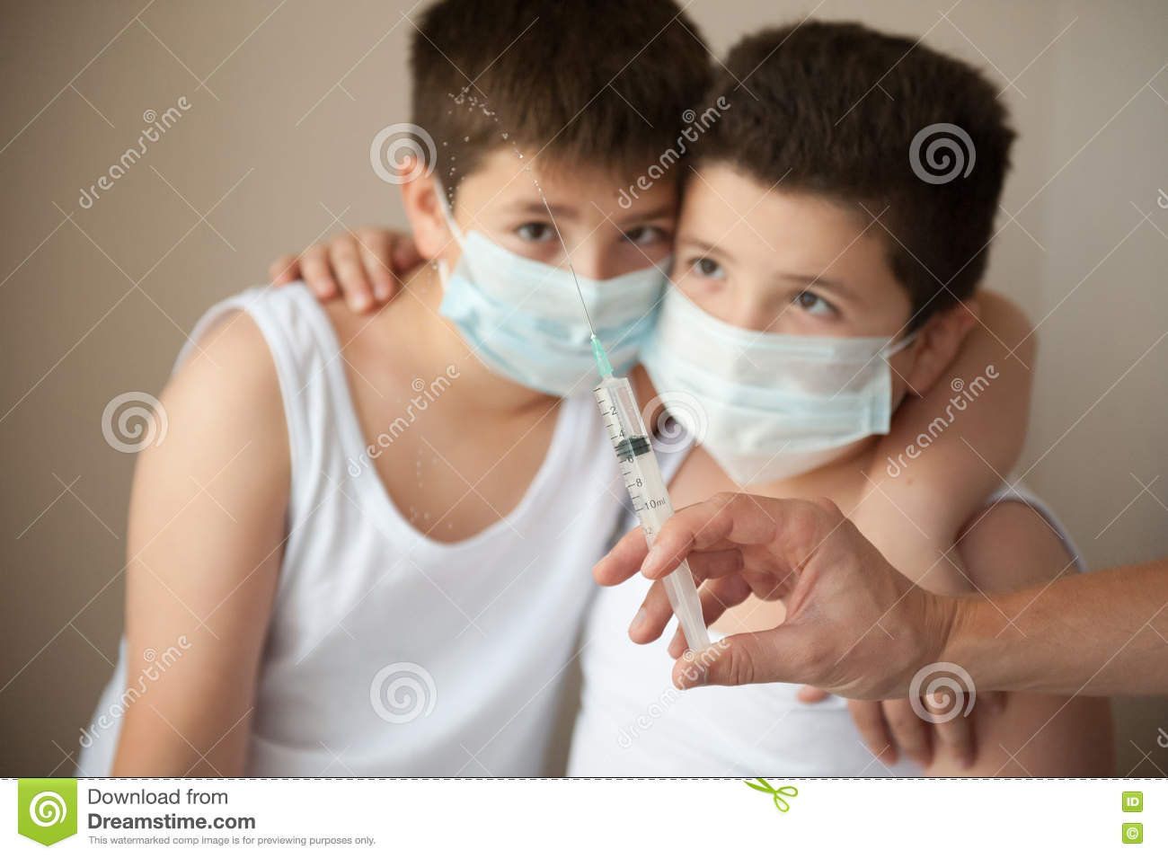 Two Syringe Boys Looking Mask Scared Stock Hand At In Medical With