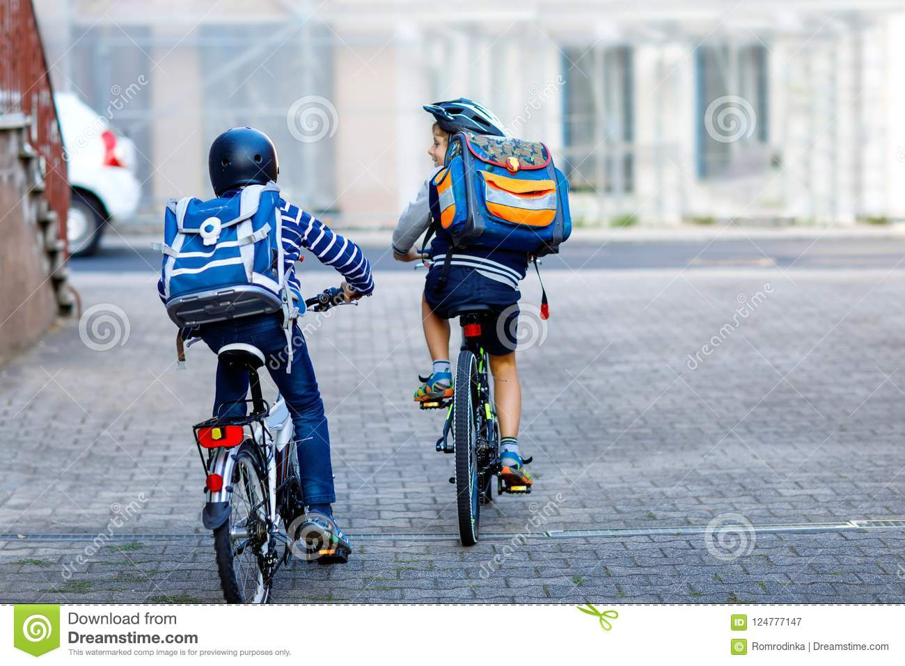 Two School Kid Boys In Safety Helmet Riding With Bike In The City With Backpacks Happy Children In Colorful Clothes Stock Image Image Of Bicycle Friends 124777147
