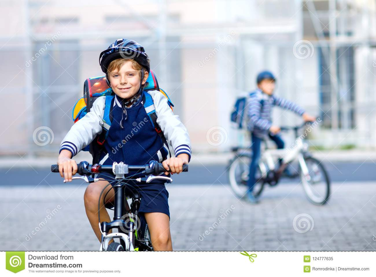 Two School Kid Boys In Safety Helmet Riding With Bike In The City With Backpacks Happy Children In Colorful Clothes Stock Image Image Of City Elementary 124777635