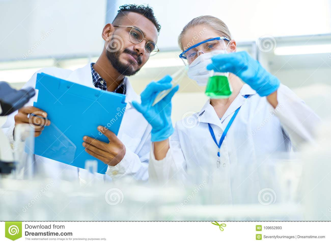 Two Scientists Working In Chemical Laboratory Stock Image - Image of