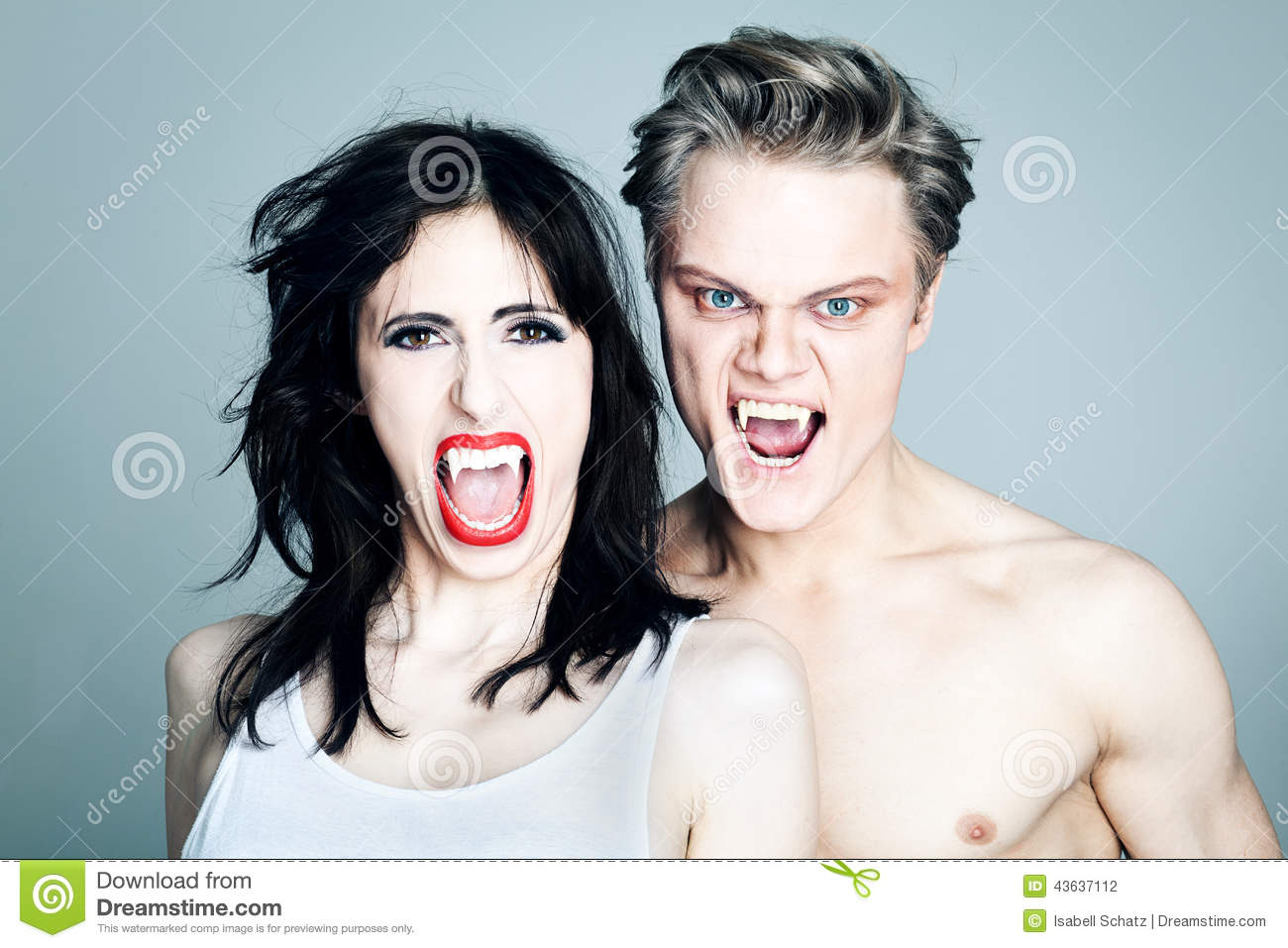 Two screaming Vampires showing their fangs
