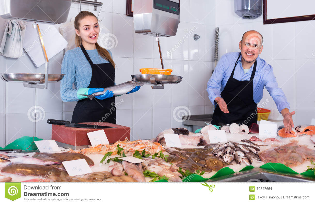 Two sellers in fish store stock photo image 70847664 for Fresh fish store