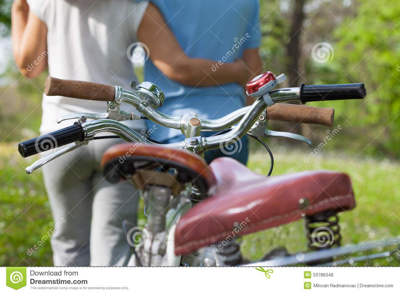 Two seniors with bicycles