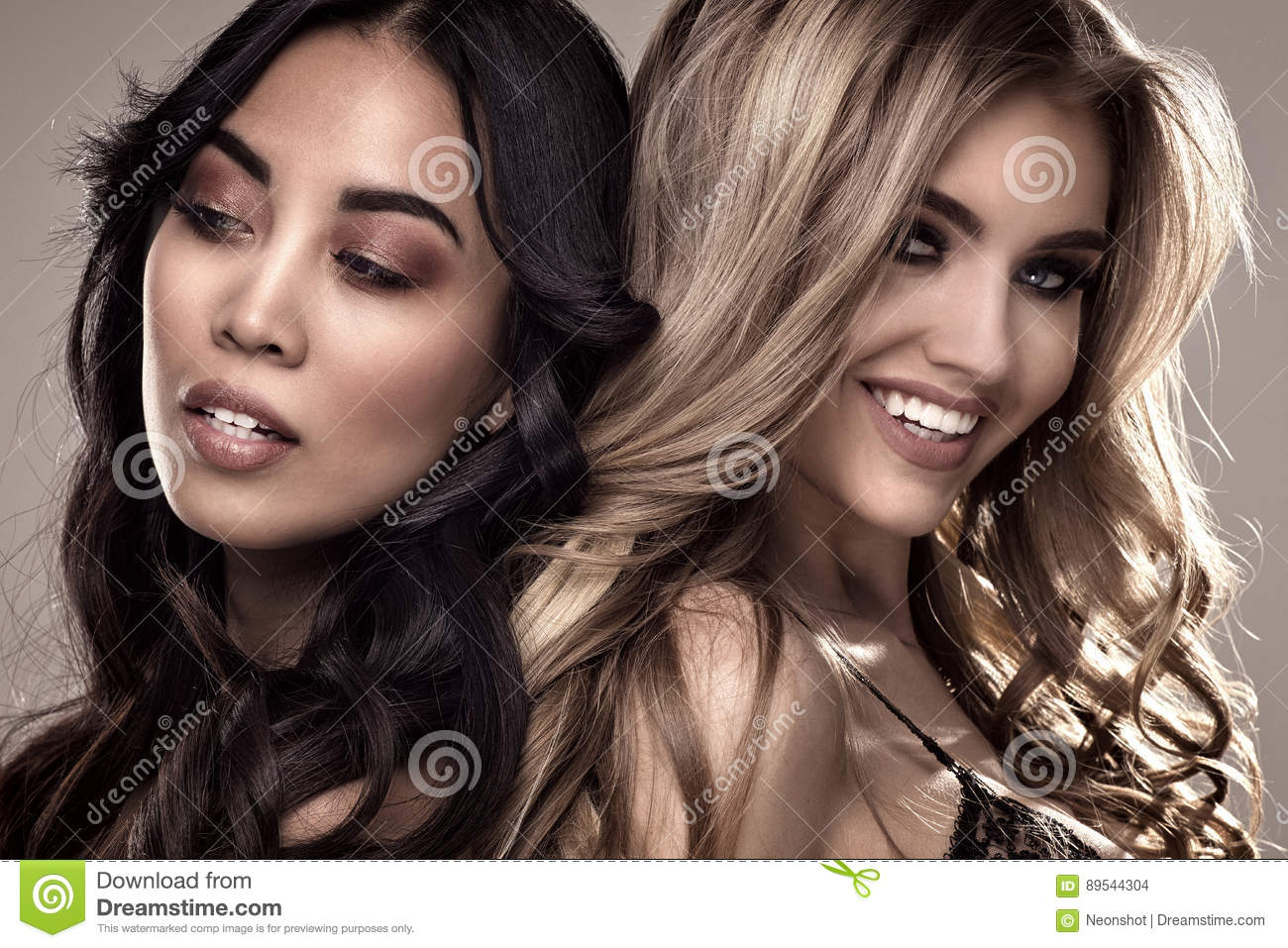 two sensual girls posing together. stock photo - image of background