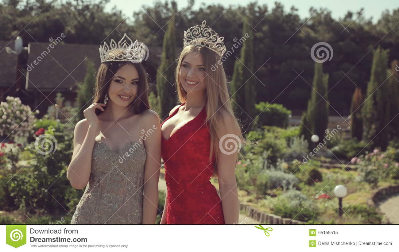 Two Young Girls In Evening Gowns And Crowns Stock Video - Video of ...