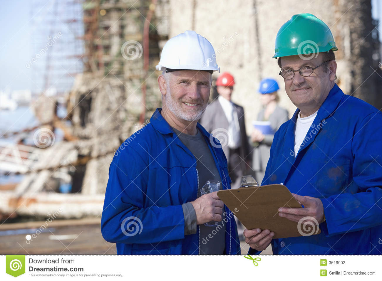 Two shipping engineers taking notes