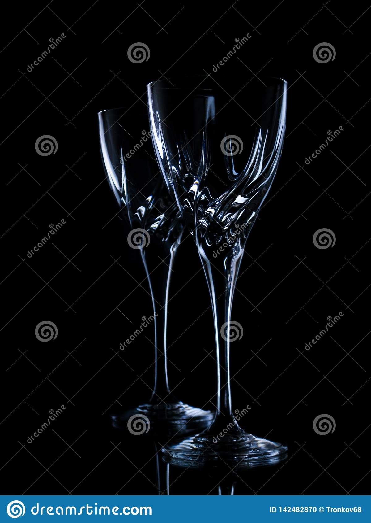 Two glasses for wine on a black background