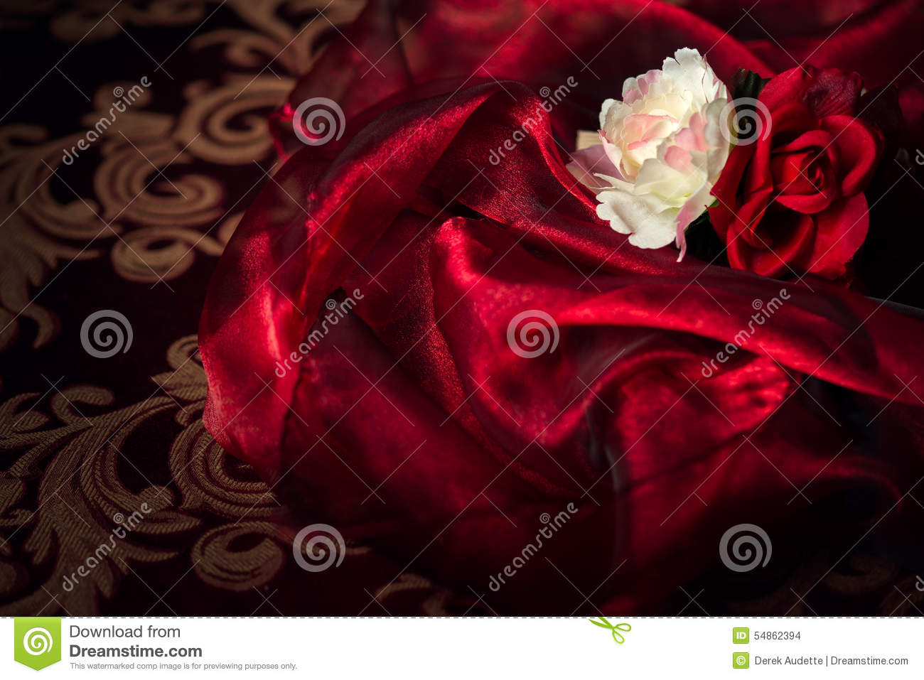 Two Silk Flowers On Red Silk Material Background Stock Photo Image