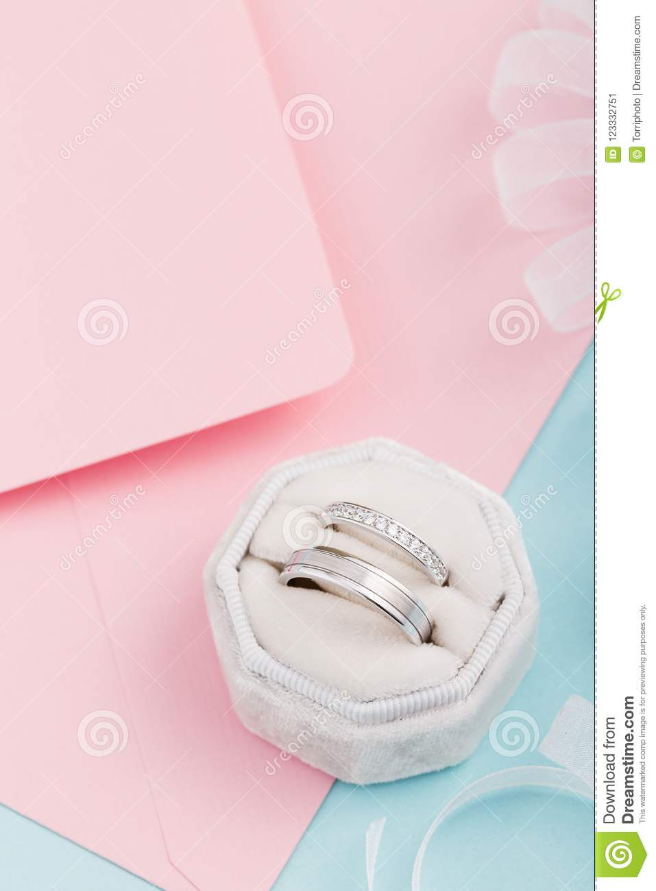 Two Silver Wedding Rings With Diamonds On Pink Background Stock ...