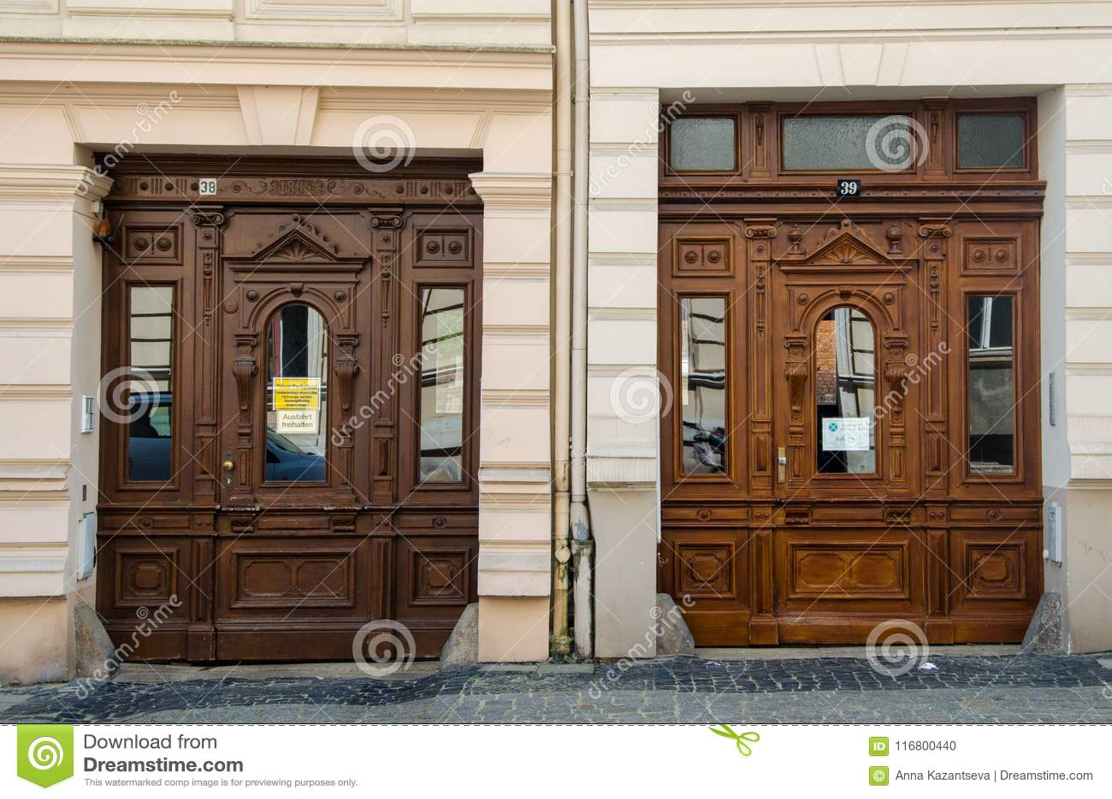 Two similar ancient decorated doors in Gorlitz, Germany