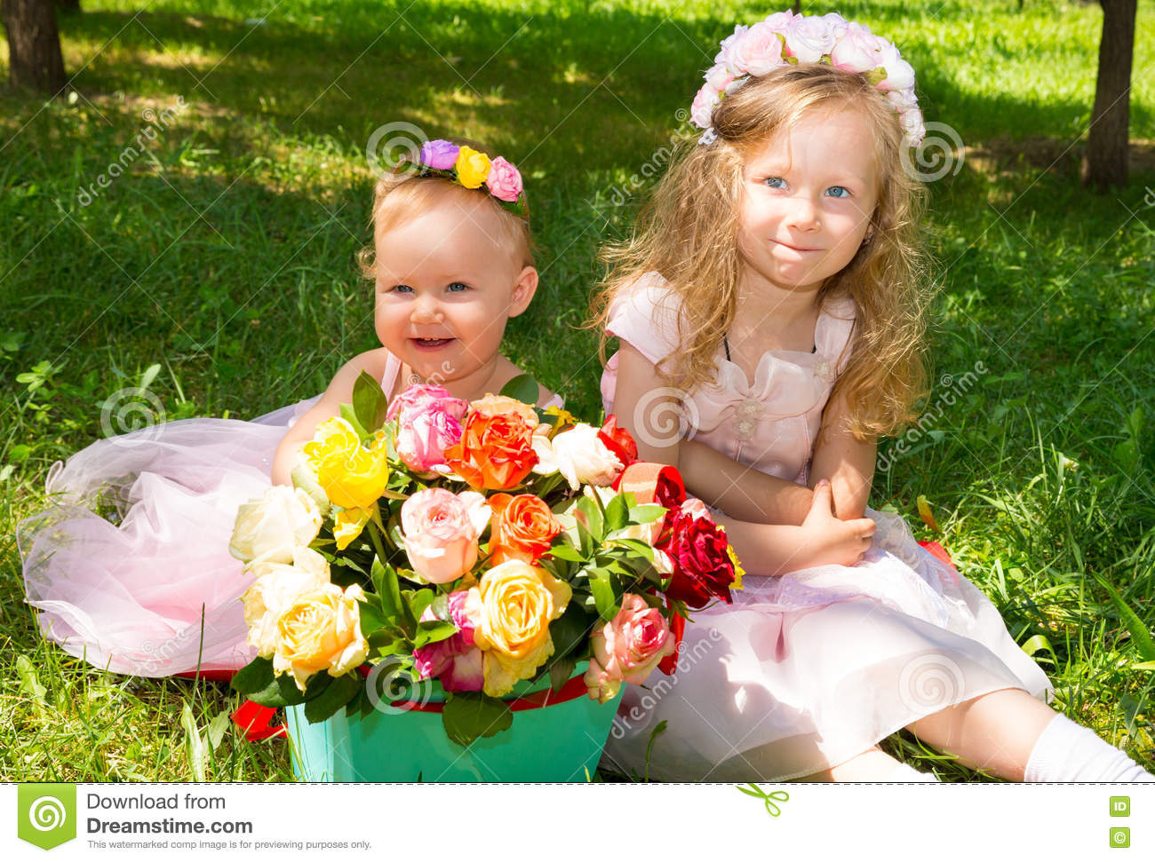 Two Sisters Adorable Little Child Girls With Bouquet Of Flowers On