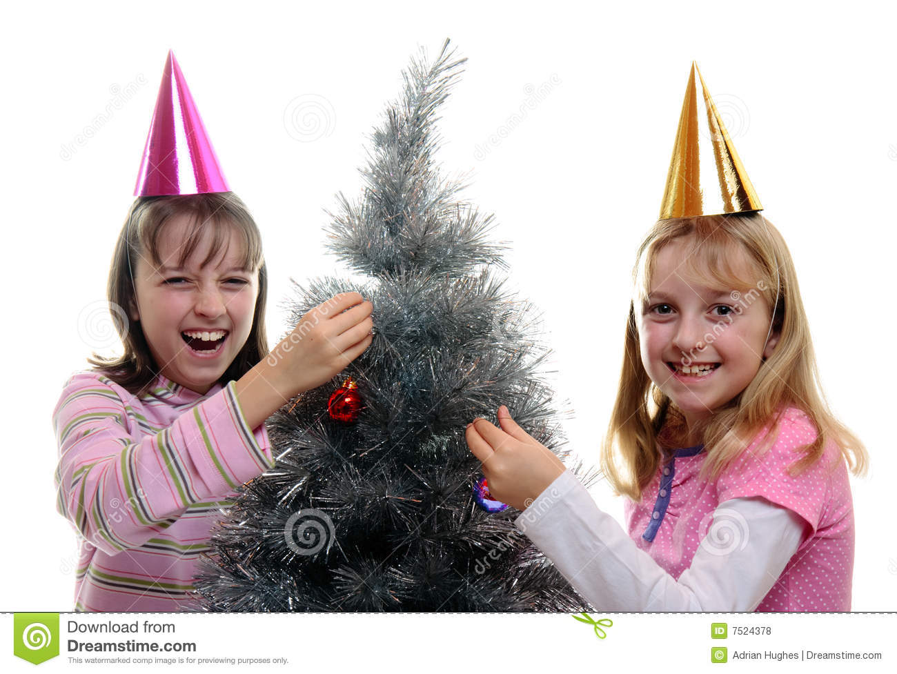 Two Sisters Dressing The Christmas Tree Stock Photo