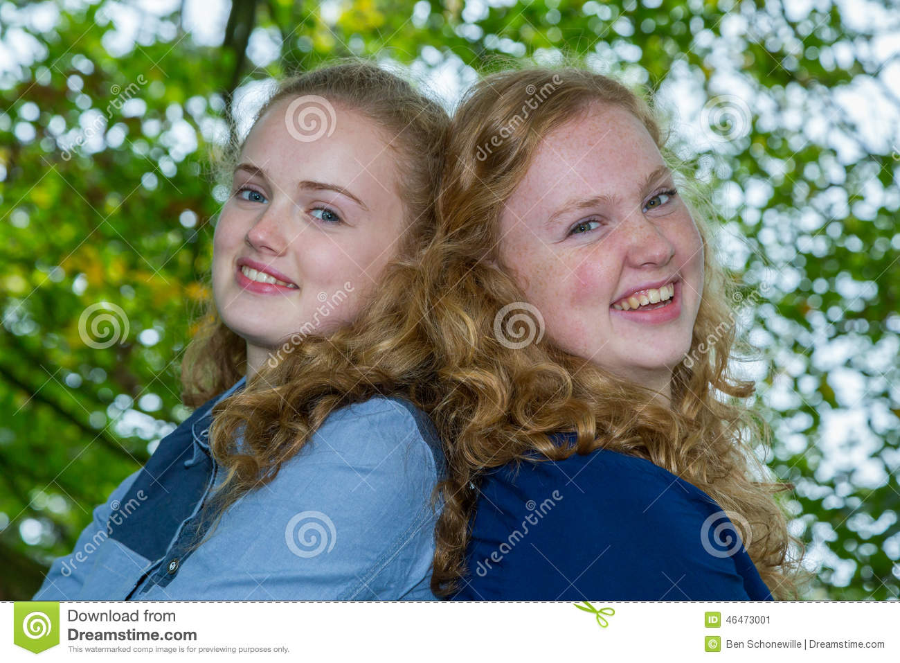 Two Sisters Heads Together Under Tree Stock Photo - Image ...