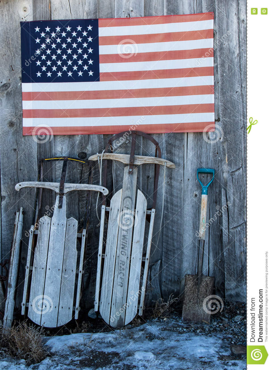 Two sleds and an American flag
