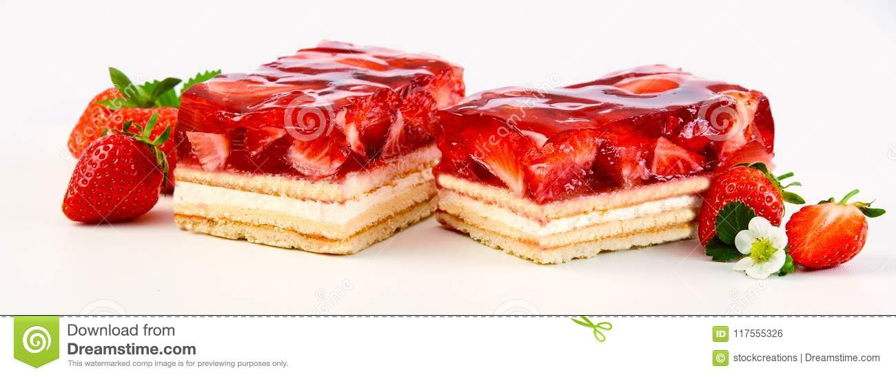 Two slices of strawberry and cream layer cake