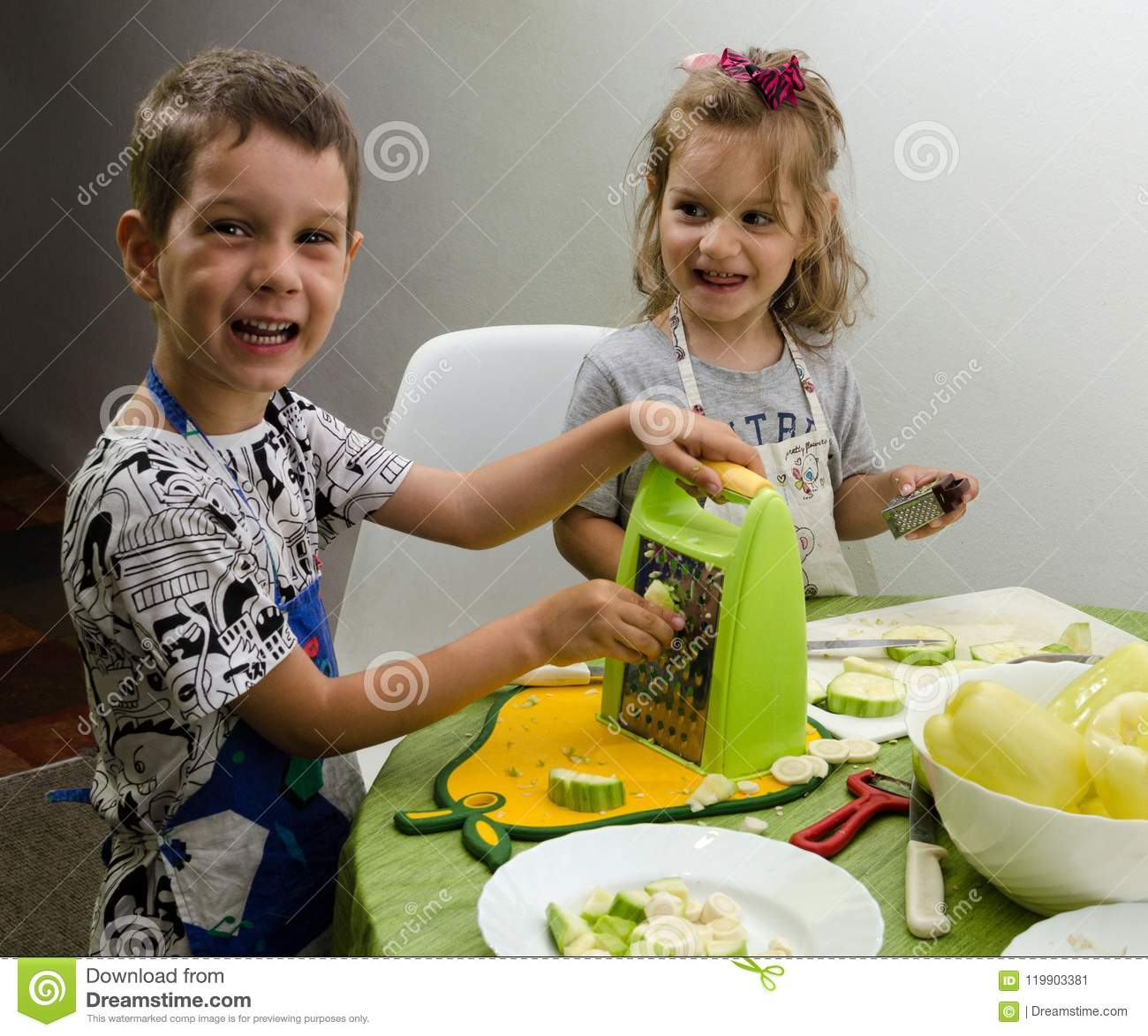 Two small children preparing a meal