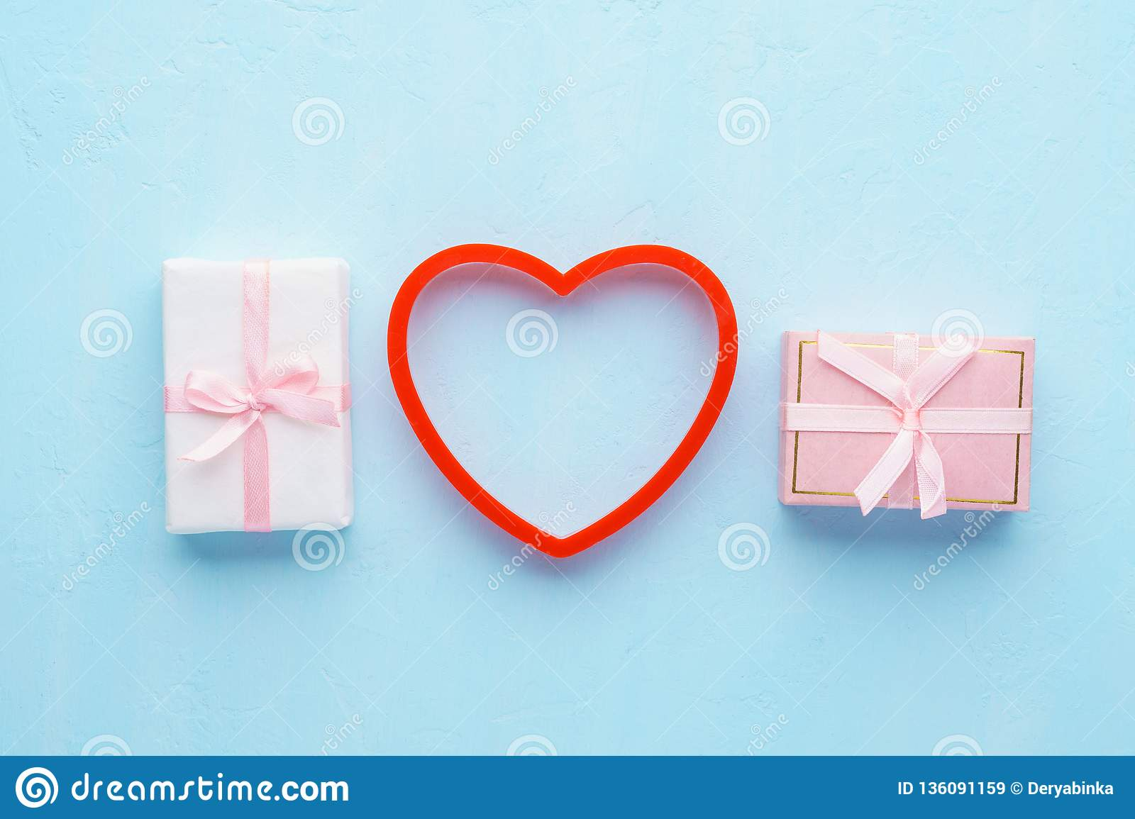 Two Small Gift Boxes With Pink Ribbon And Red Heart Stock Image
