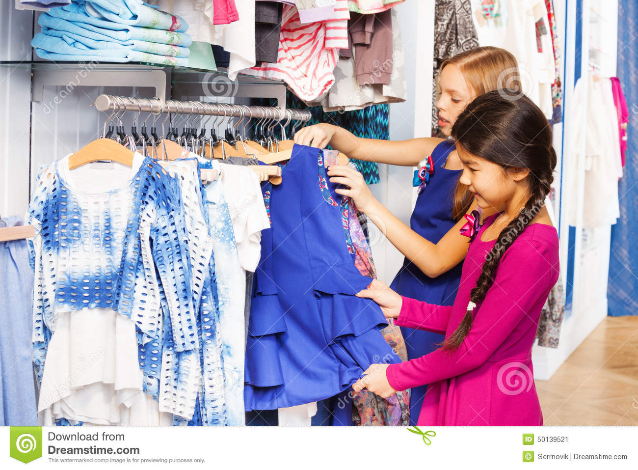 afb03badf1 Two Small Girls Shop Together In The Clothes Store Stock Image ...
