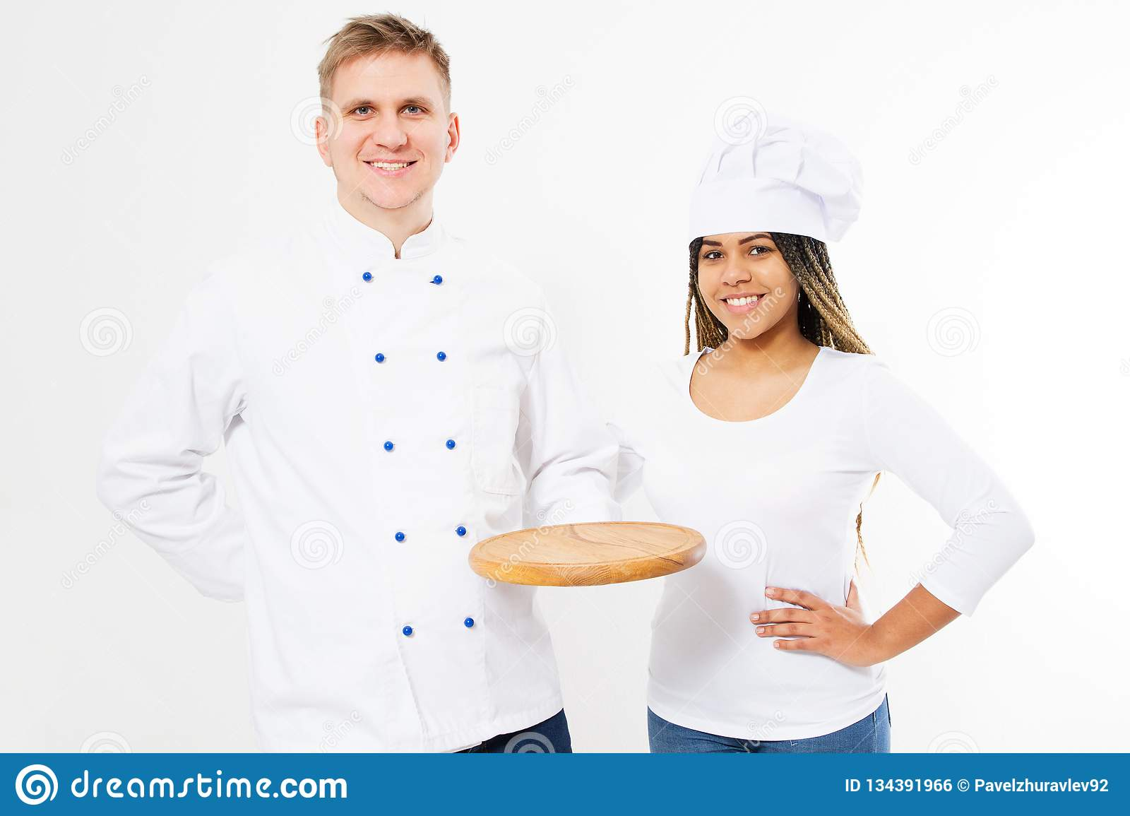 Two smiling chefs hold empty pizza desk isolated on white background