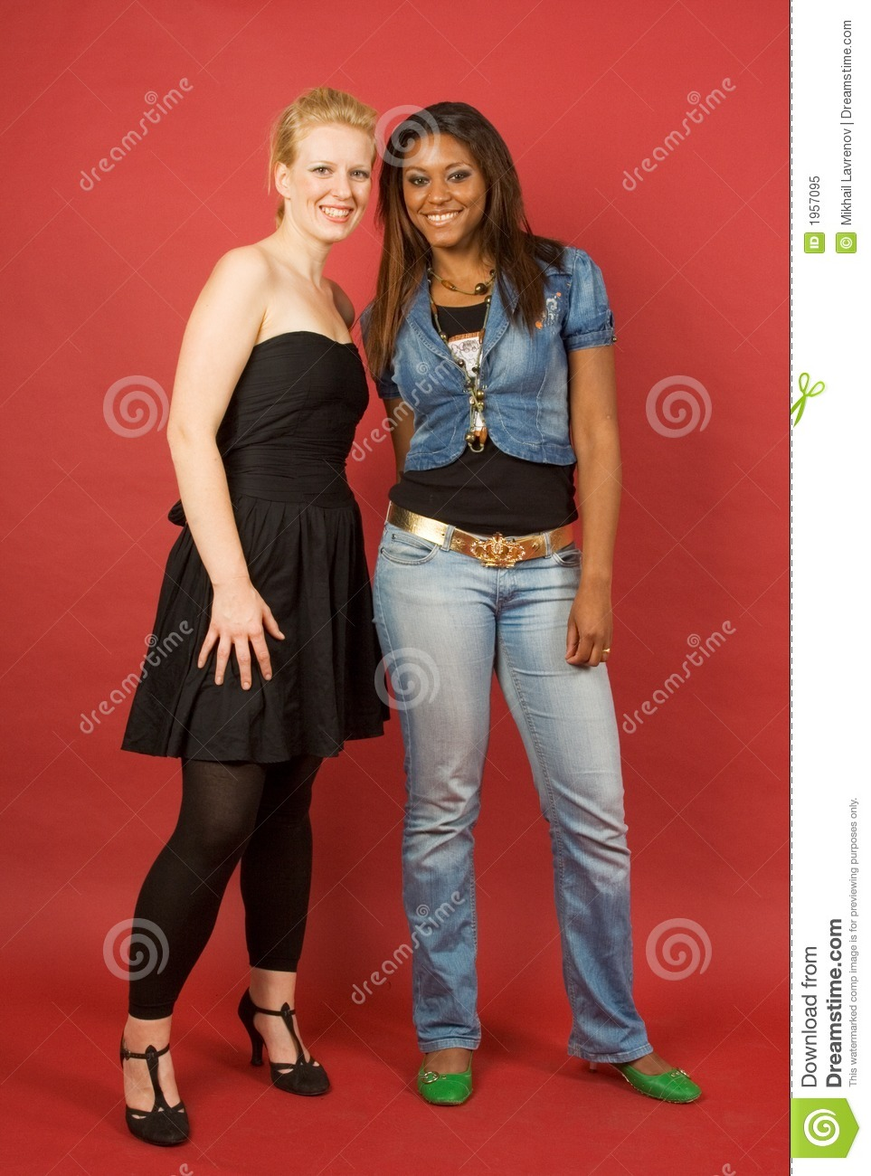 Two smiling girls on red