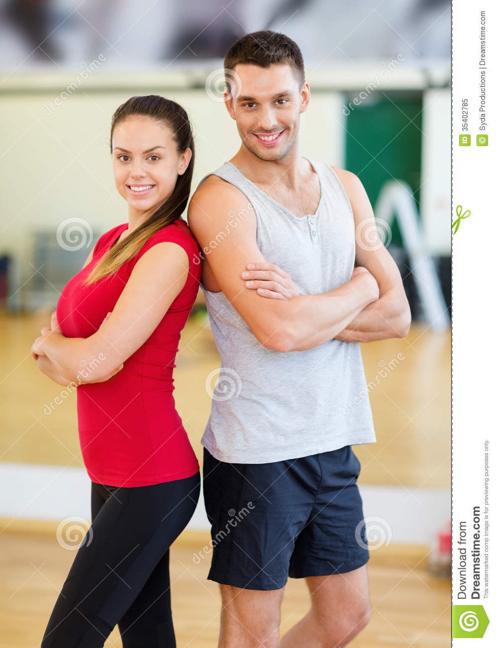 Two smiling people in the gym royalty free stock photo for Gimnasio sport gym