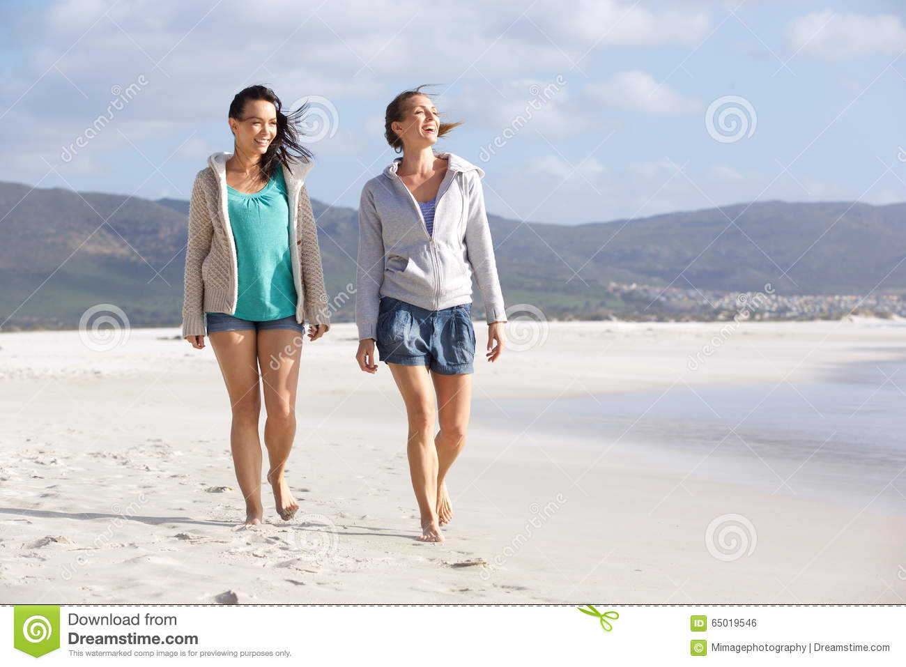 Woman walking on a beach royalty - Royalty Free Stock Photo Download Two Smiling Women Friends Walking On Beach
