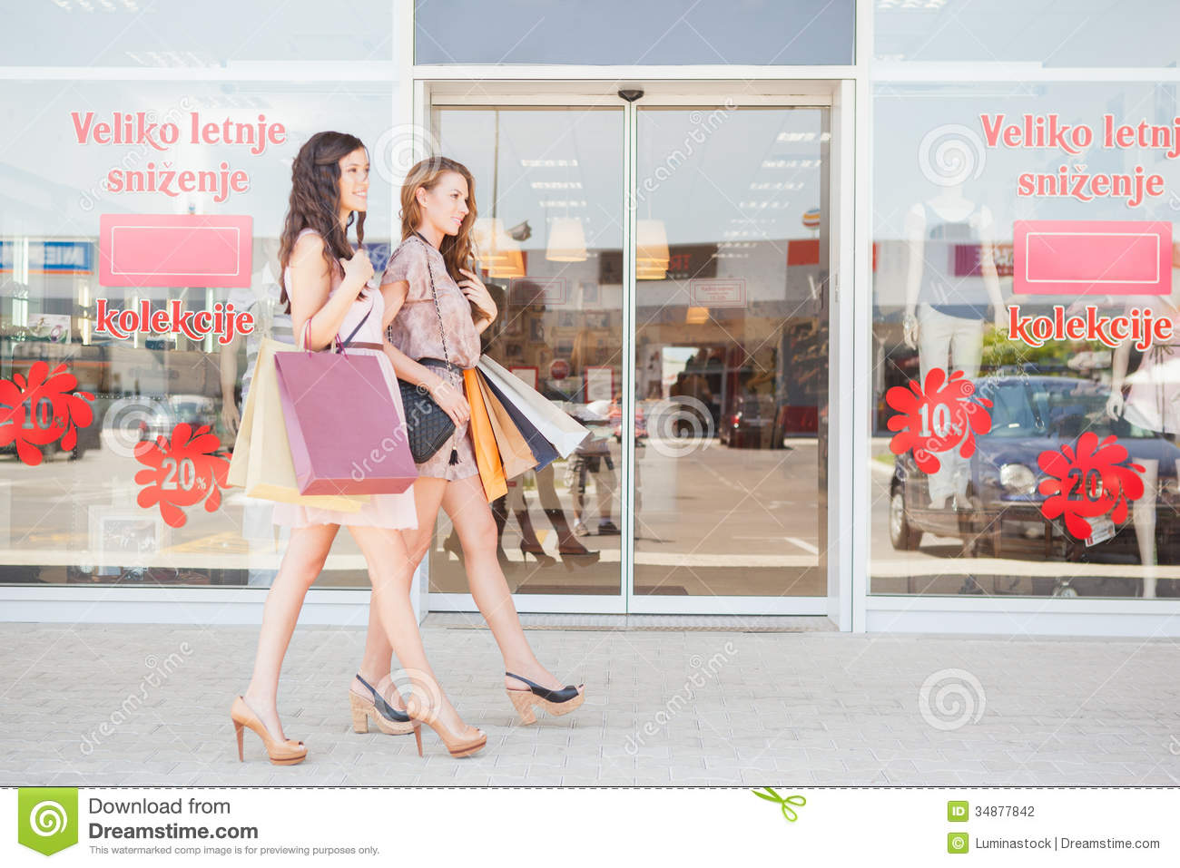two smiling women window shopping stock photo image of young