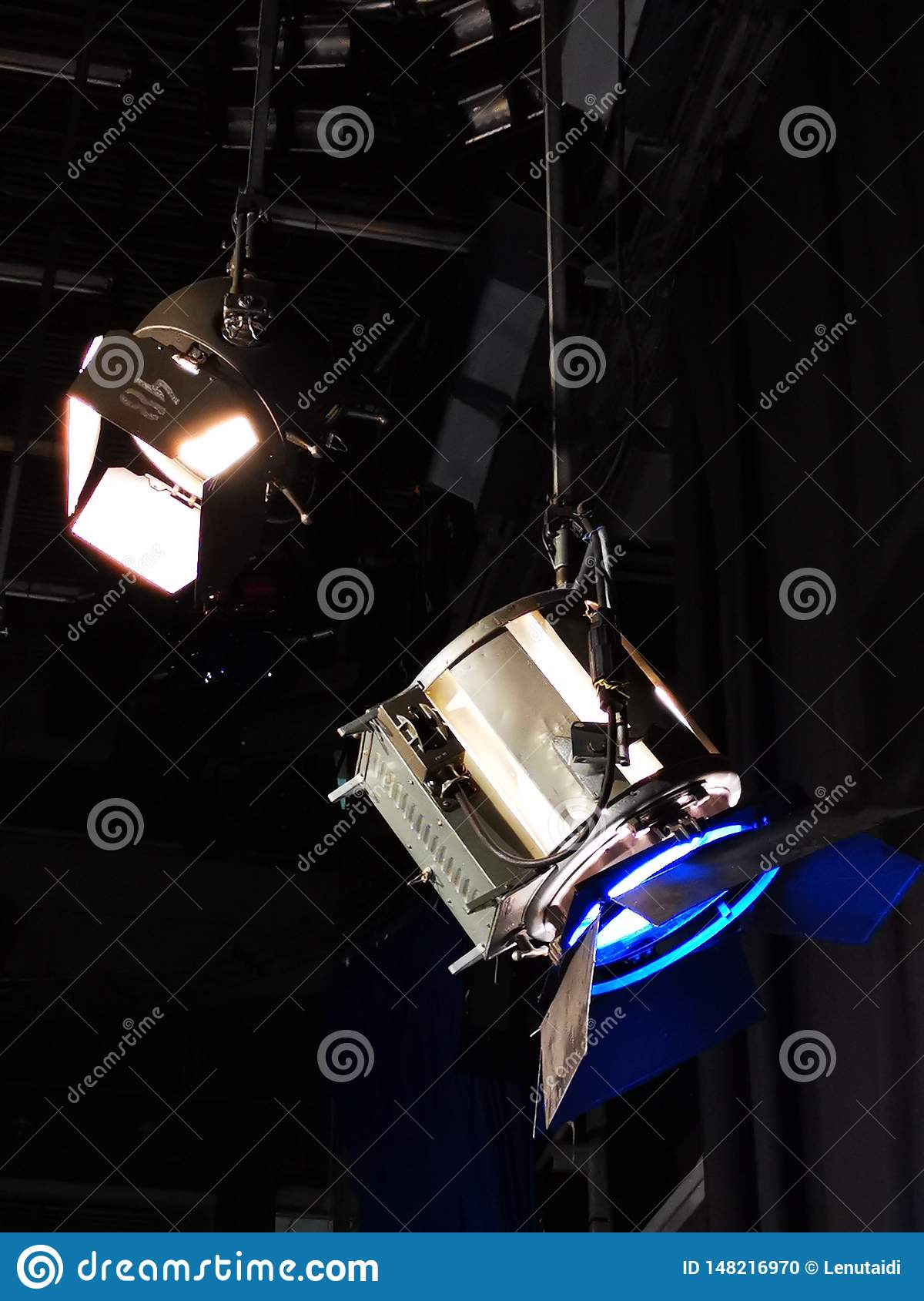 Two spotlights - one with a blue filter