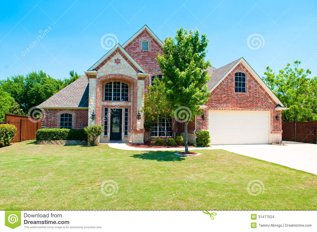 Two story brick home with the garage in the front stock for Brick garages prices