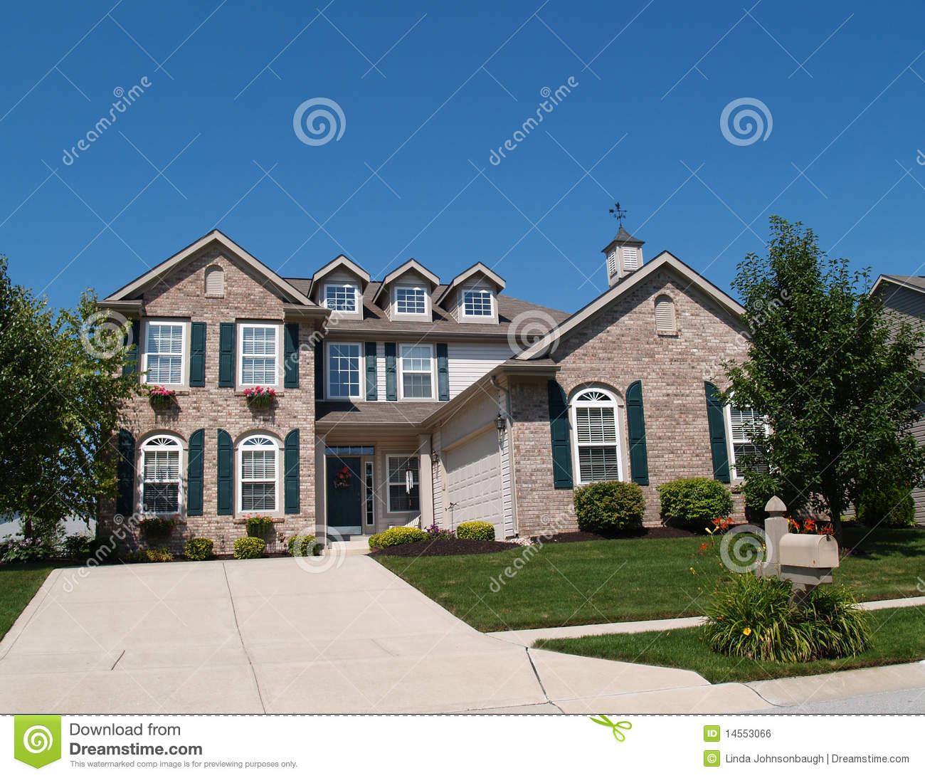Two Story Brick Home With Window Boxes Royalty Free Stock