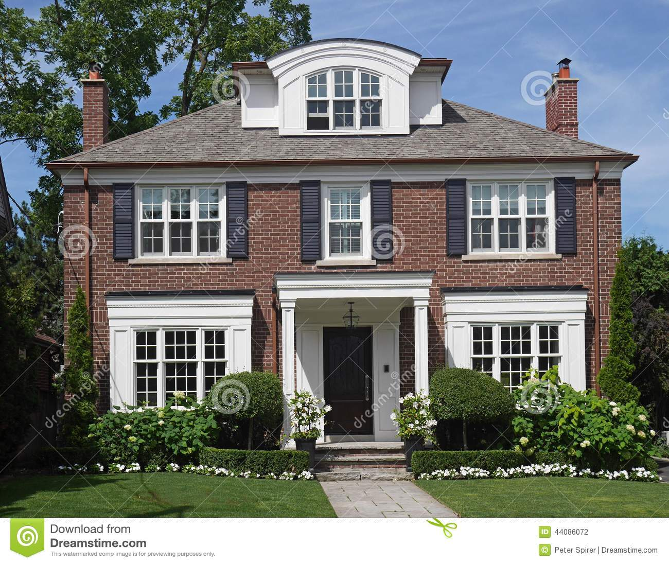 Two story brick house stock photo image 44086072 for Traditional 2 story house