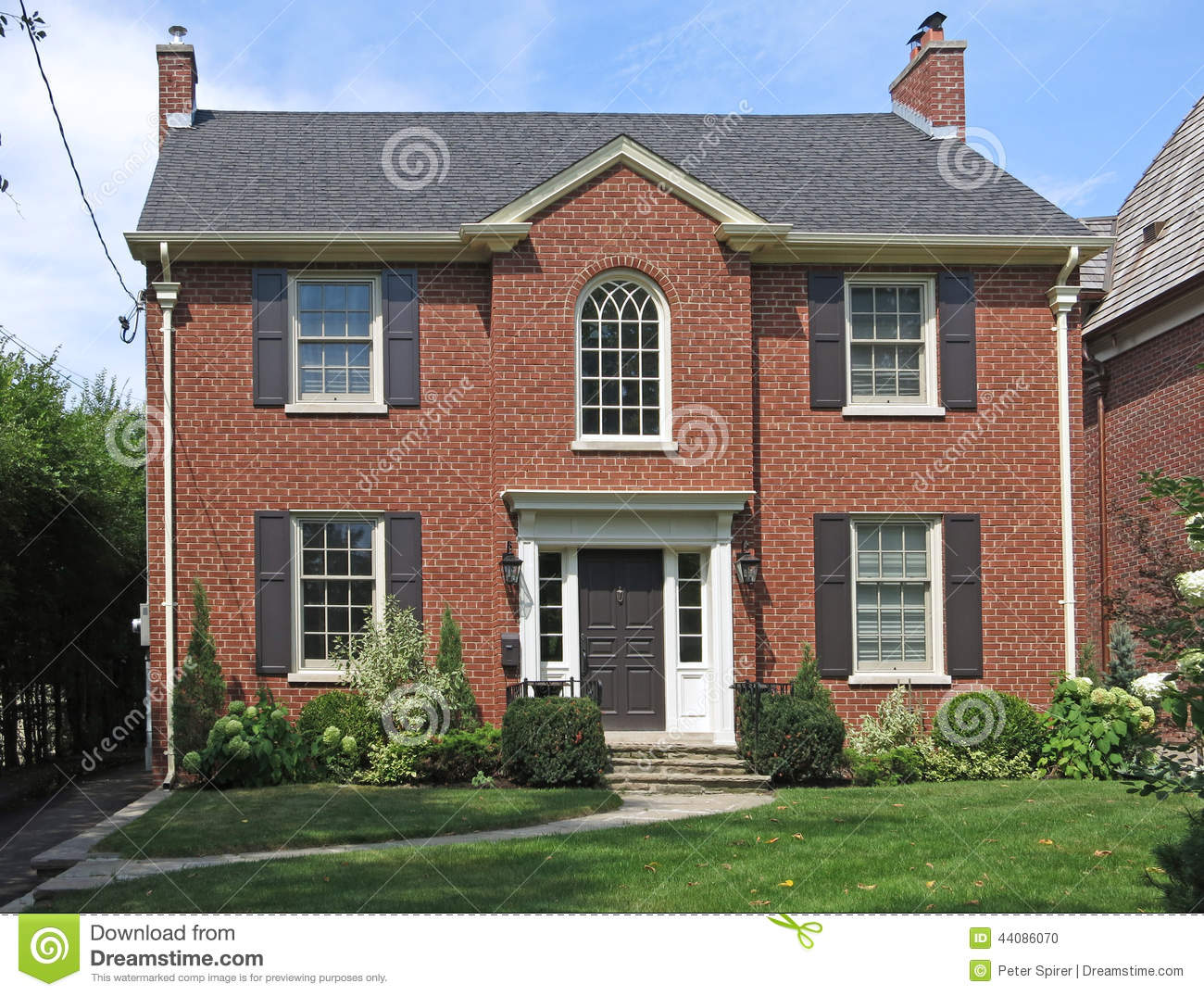Two story brick house stock photo image of front for Traditional 2 story house