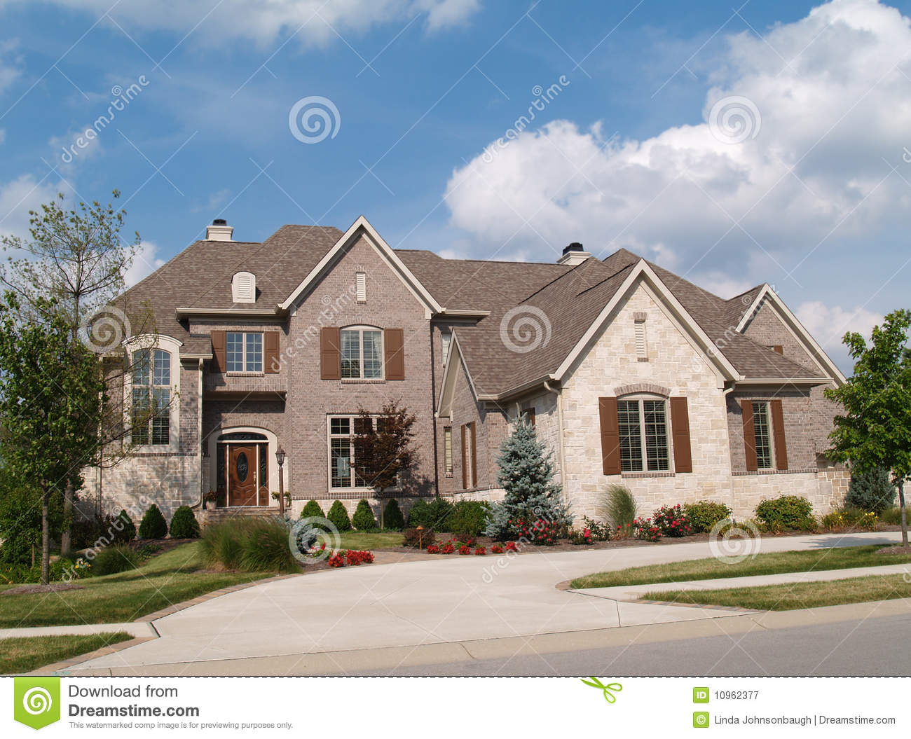 Two story brick and stone home royalty free stock for Stone homes