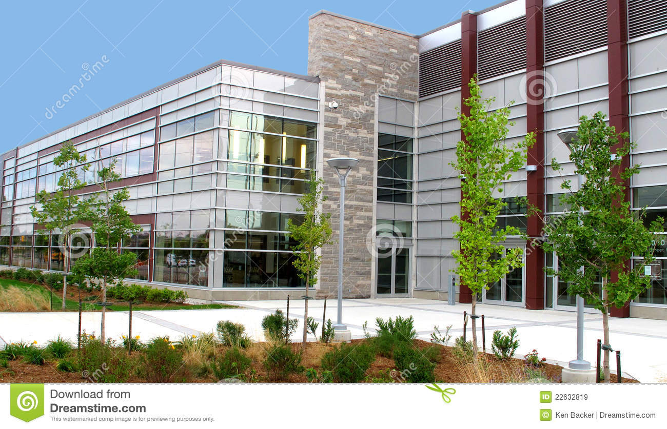 Modern two story commercial building with landscaping