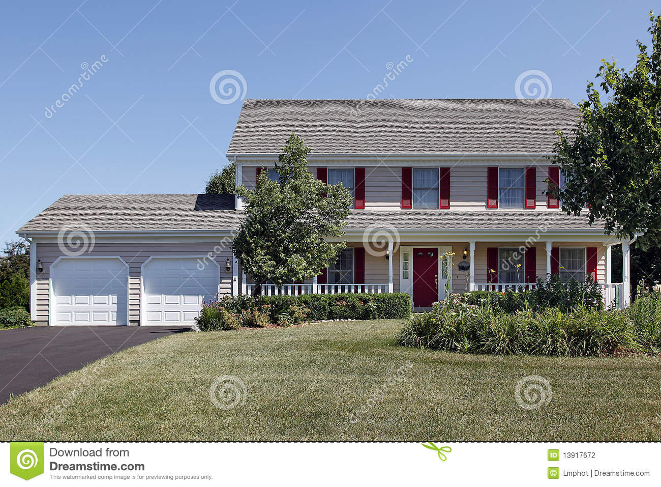 Two Story Home With Front Porch And Red Shutters Stock