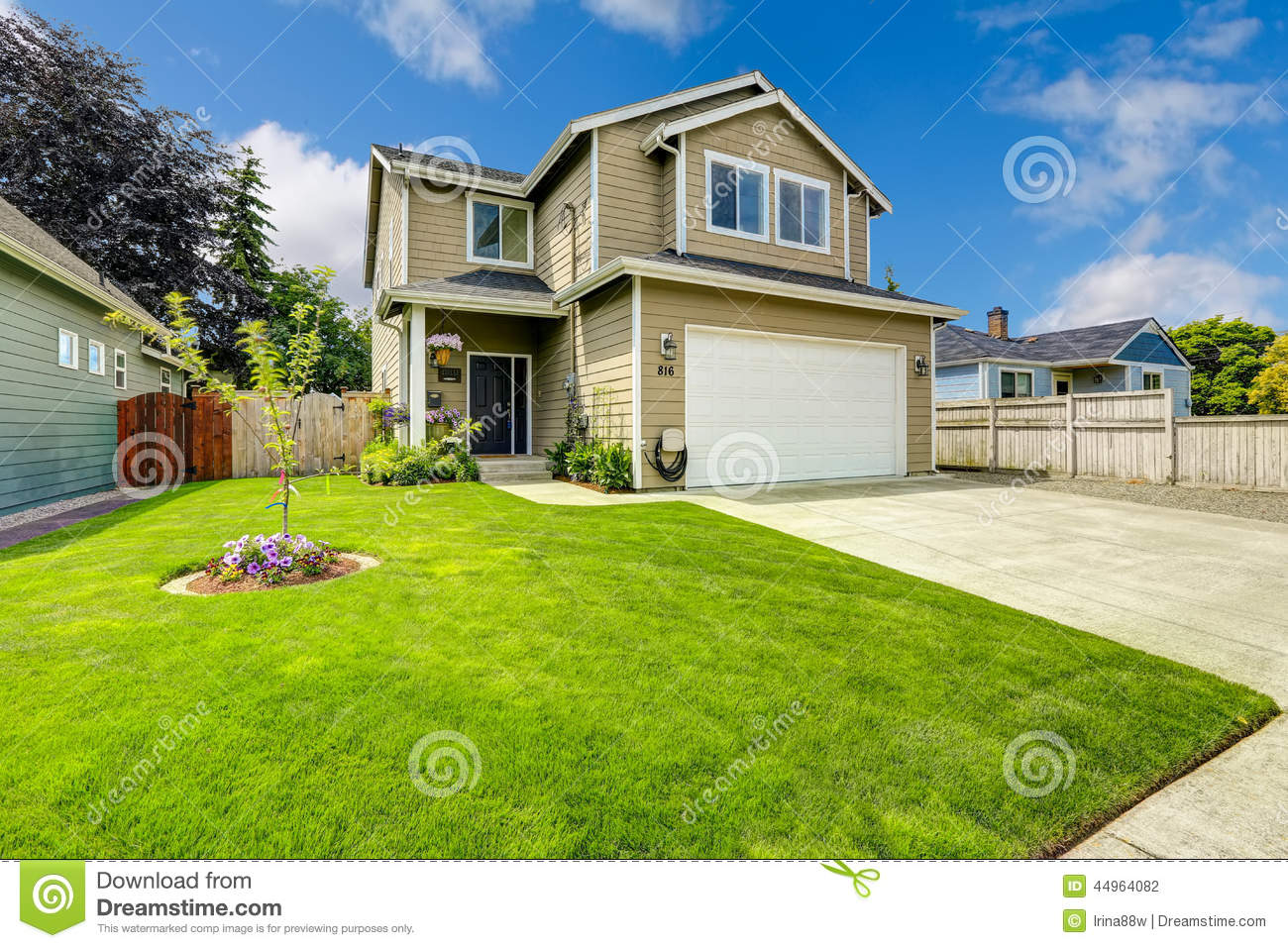Two story house exterior with front yard landscape stock for House backyard landscape
