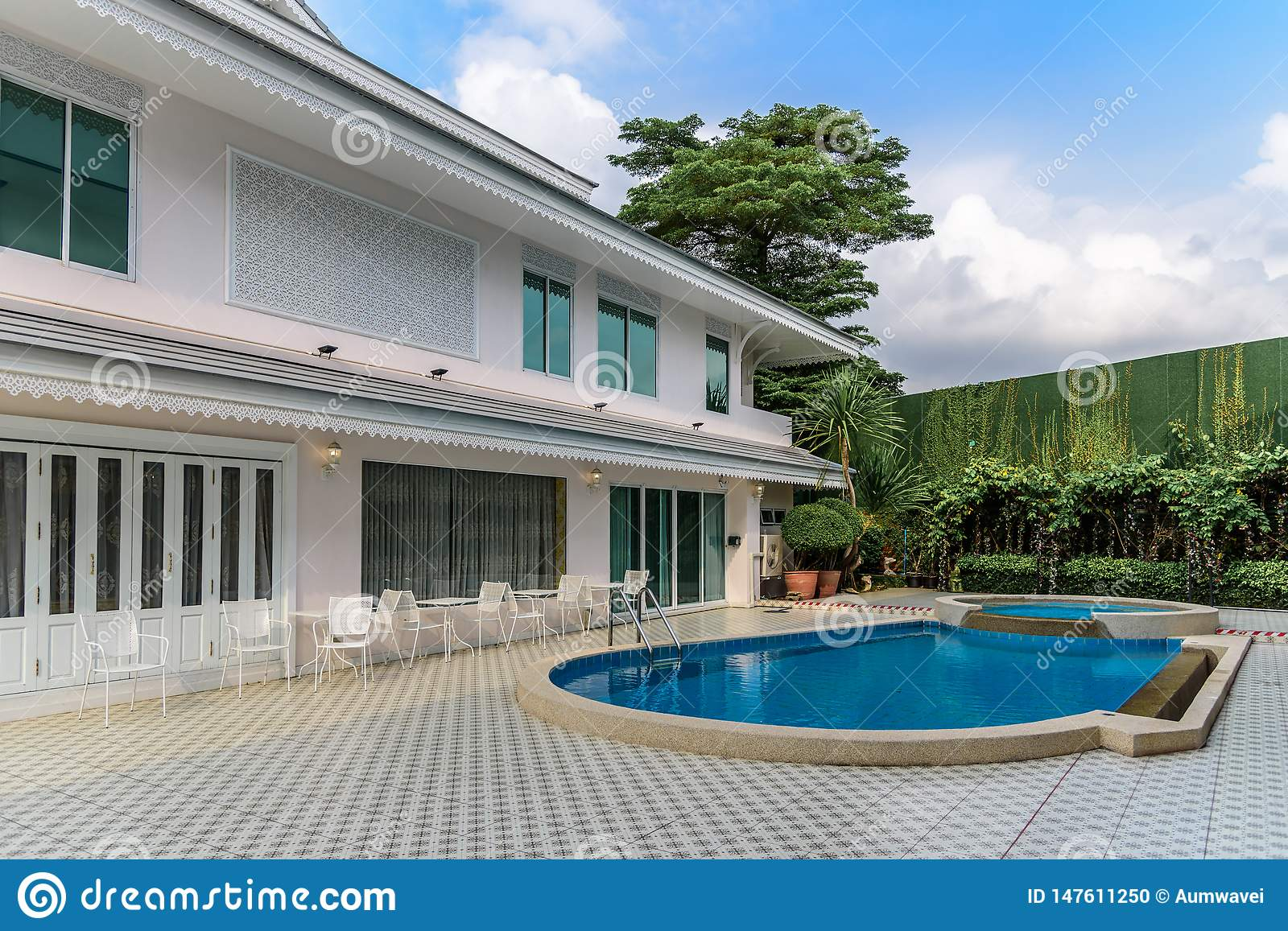 Two-story house with fence and swimming pool