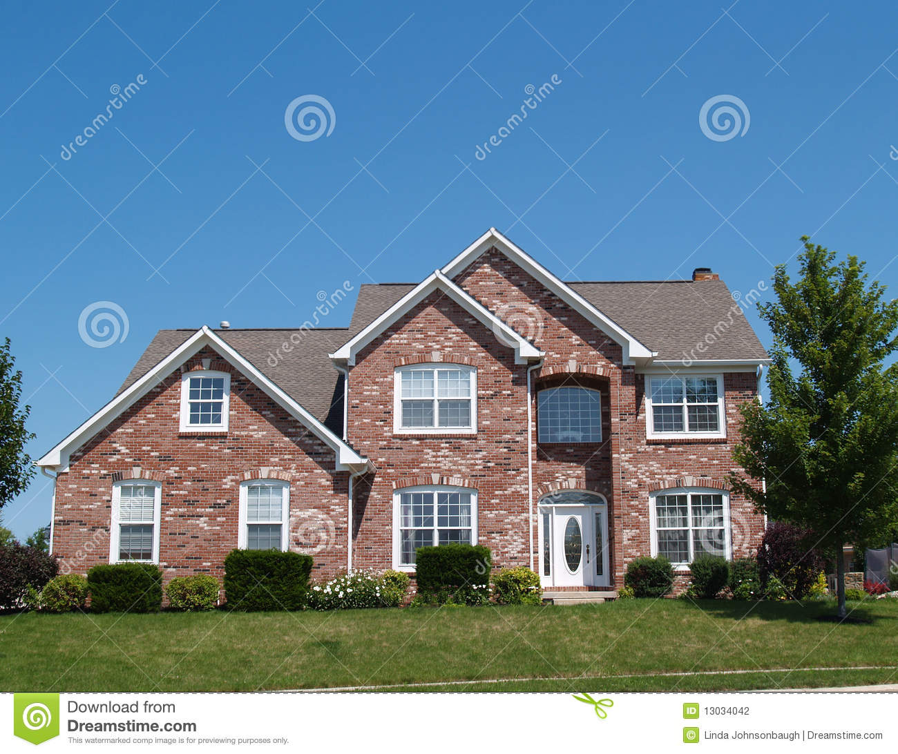 American red brick two story house exterior with garage for New two story homes