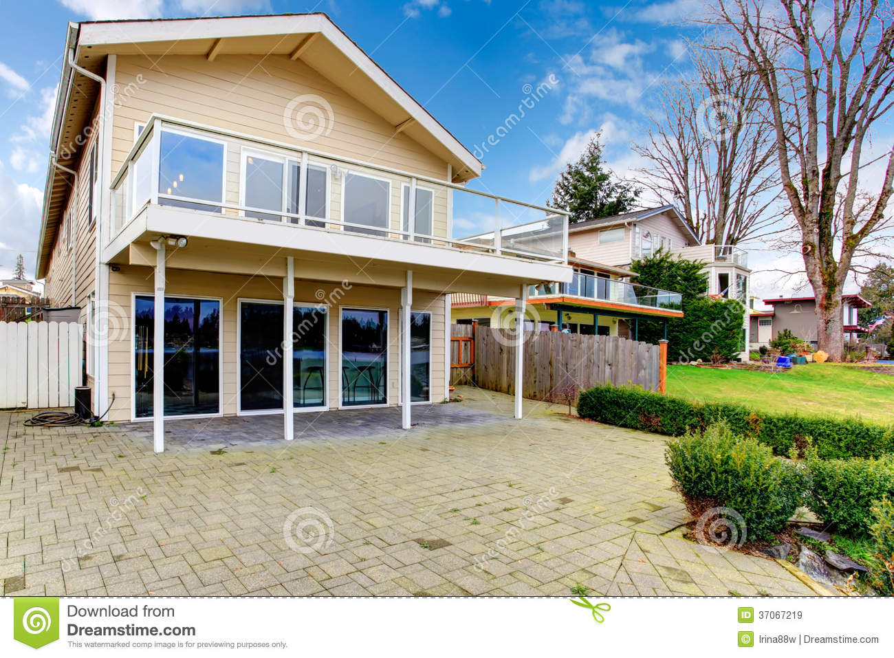 Two story paneled house with glass balcony royalty free for Two story homes with balcony