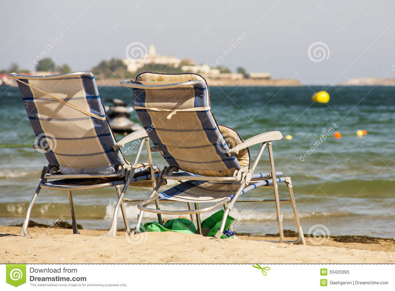 Two sun loungers by the sea