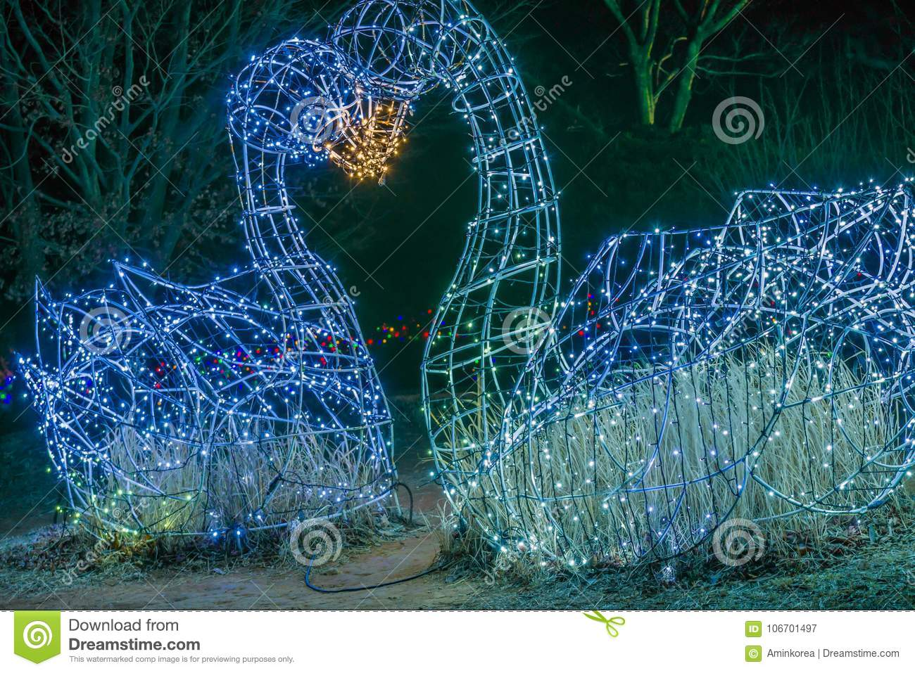 Two Swan Figurines Made Of Lights Kissing Stock Image - Image of ...