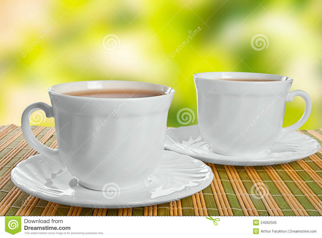 Two teacups on abstract background.
