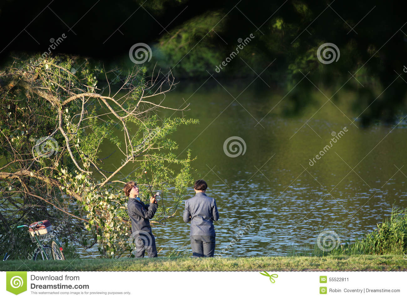 Two teenage amish boys fishing editorial photo image for Local pond stores
