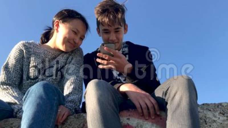 Image of: Clips Two Teenagers Sitting In The Street And Watching Funny Videos On The Phone Stock Video Video Of Communication Lifestyle 122336091 Create Youtube Two Teenagers Sitting In The Street And Watching Funny Videos On The